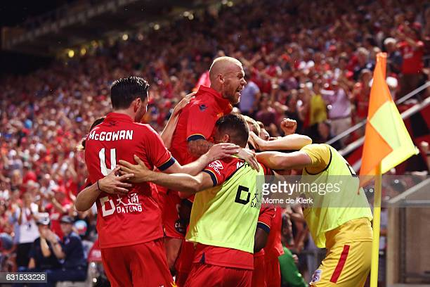 Adelaide players celebrate the winning goal by Mark Ochieng during the round 15 ALeague match between Adelaide United and Melbourne City FC at...