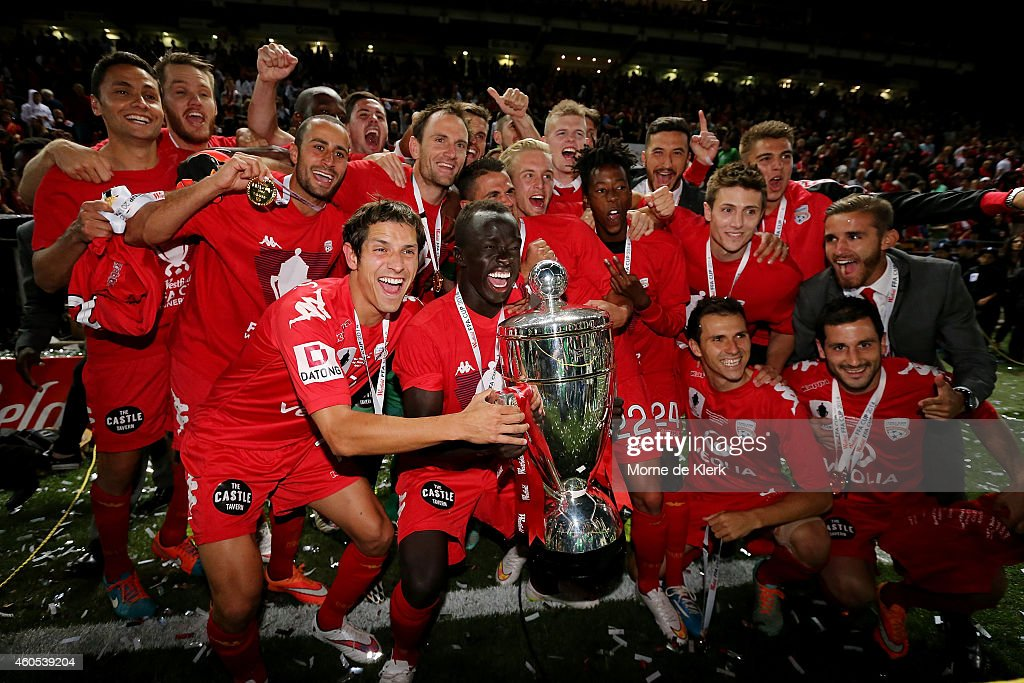 Adelaide players celebrate with the cup after winning the FFA Cup Final match between Adelaide United and Perth Glory at Coopers Stadium on December 16, 2014 in Adelaide, Australia.