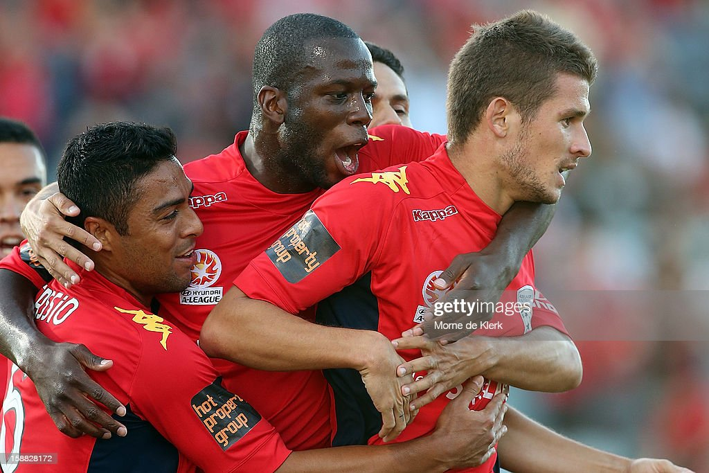 Adelaide players congratulate team mate Dario Vidosic (R) after he scored a goal during the round 14 A-League match between Adelaide United and Sydney FC at Hindmarsh Stadium on December 31, 2012 in Adelaide, Australia.