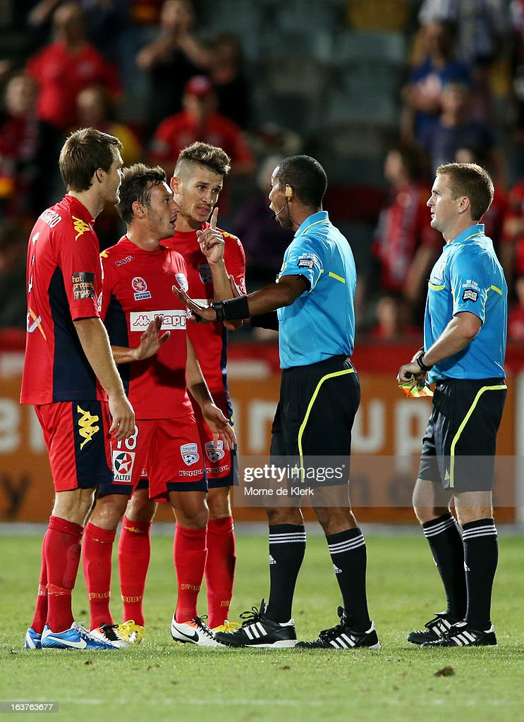 Adelaide players including Dario Vidosic speak to the Referee after the round 25 A-League match between Adelaide United and the Newcastle Jets at Hindmarsh Stadium on March 15, 2013 in Adelaide, Australia.