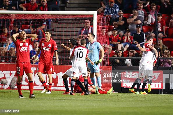 Adelaide players look on as Brendon Santalab of the Wanderers celebrate scoring the winning goal during the round two ALeague match between Adelaide...