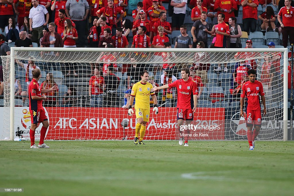 Adelaide players react after a goal was scored by Brisbane during the round 13 A-League match between Adelaide United and the Brisbane Roar at Hindmarsh Stadium on December 26, 2012 in Adelaide, Australia.