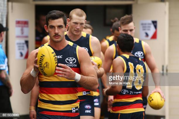 Adelaide players walk out onto the field before the JLT Community Series AFL match between the Adelaide Crows and the Brisbane Lions at Hickinbotham...