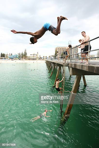 Adelaide residents escape the heat by jumping from the jetty into the ocean at Glenelg beach on December 19 2015 in Adelaide Australia Adelaide is...