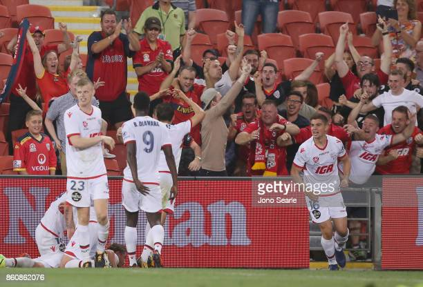 Adelaide team mates celebrate the eualiser during the round two ALeague match between the Brisbane Roar and Adelaide United at Suncorp Stadium on...