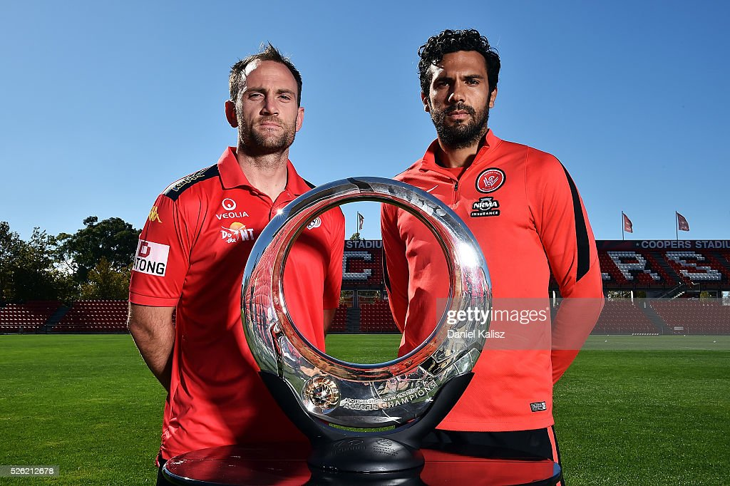 Adelaide United captain Eugene Galekovic and the Wanderers captain <a gi-track='captionPersonalityLinkClicked' href=/galleries/search?phrase=Nikolai+Topor-Stanley&family=editorial&specificpeople=2517636 ng-click='$event.stopPropagation()'>Nikolai Topor-Stanley</a> pose for a photo with the Hyundai Championship A-League trophy during the media during the A-League Grand Final press conference at Coopers Stadium on April 30, 2016 in Adelaide, Australia.