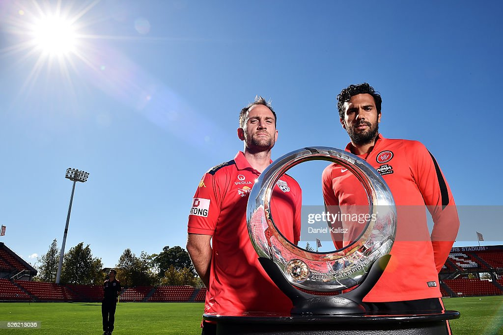 Adelaide United captain Eugene Galekovic and the Wanderers captain Nikolai Topor-Stanley pose for a photo with the Hyundai Championship A-League trophy during the media during the A-League Grand Final press conference at Coopers Stadium on April 30, 2016 in Adelaide, Australia.