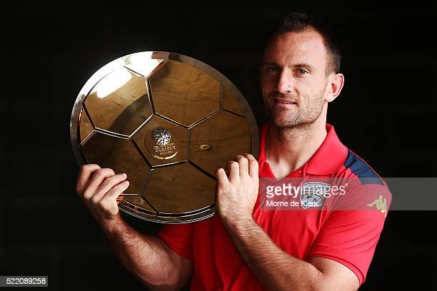 Adelaide United captain Eugene Galekovic holds the Premiers Plate during an Adelaide United ALeague Finals series media opportunity at Coopers...