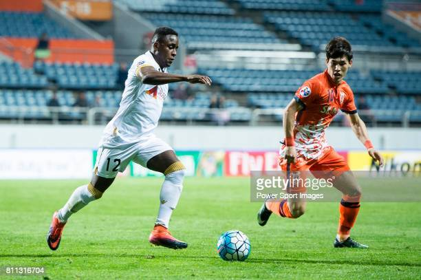 Adelaide United Defender Mark Ochieng fights for the ball with Jeju United Midfielder Lee Changmin during the AFC Champions League 2017 Group Stage...