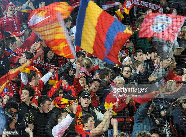 Adelaide United fans cheer during the round one ALeague match between Adelaide United and Perth Glory at Hindmarsh Stadium on August 7 2009 in...