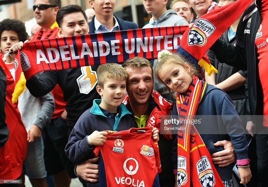 Adelaide United fans pose for a photo during the Adelaide United A-League Grand Final at Rundle Mall on May 2, 2016 in Adelaide, Australia.