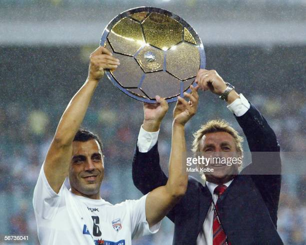 Adelaide United FC Captain Ross Aloisi and Coach John Kosmina hold the Minor Premiership trophy aloft before the start of the round 21 ALeague match...