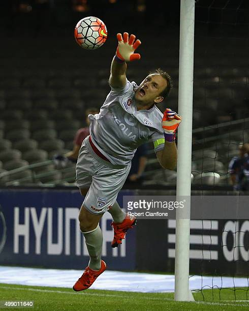 Adelaide United goalkeeper Eugene Galekovic makes a save during the round eight ALeague match between Melbourne City FC and Adelaide United at Etihad...