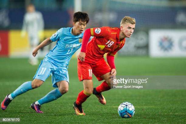 Adelaide United Midfielder Riley Patrick Mcgree in action against Jiangsu FC Midfielder Xie Pengfei during the AFC Champions League 2017 Group H...