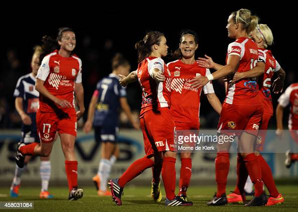 Adelaide United players celebrate a goal by LisaMarie Woods during the round 12 WLeague match between Adelaide and Melbourne at Adelaide Shores...