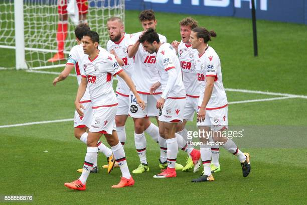 Adelaide United players celebrate a goal during the round one ALeague match between Wellington Phoenix and Adelaide United at Westpac Stadium on...
