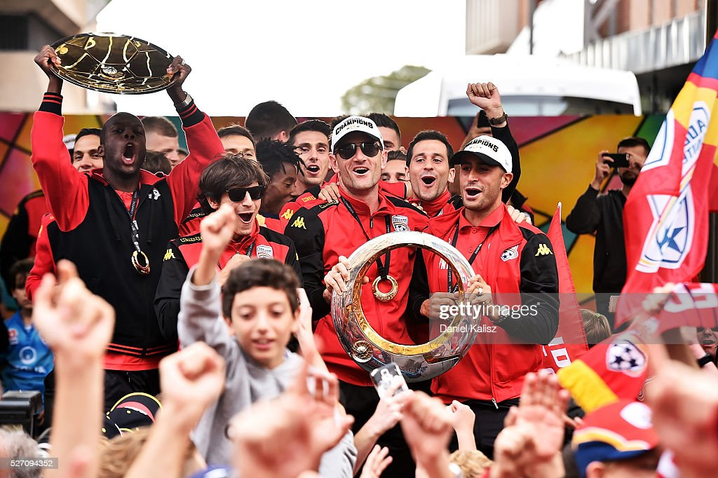 Adelaide United players celebrate with fans during the Adelaide United A-League Grand Final at Rundle Mall on May 2, 2016 in Adelaide, Australia.