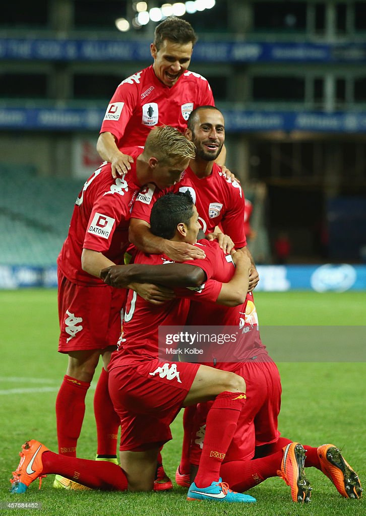 Adelaide United players congratulate Bruce Djite of Adelaide United as he celebrates after scoring a goal during the FFA Cup Quarter Final match...