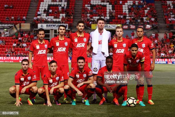 Adelaide United players pose for a team photograph before the round 19 ALeague match between Adelaide United and Perth Glory at Coopers Stadium on...