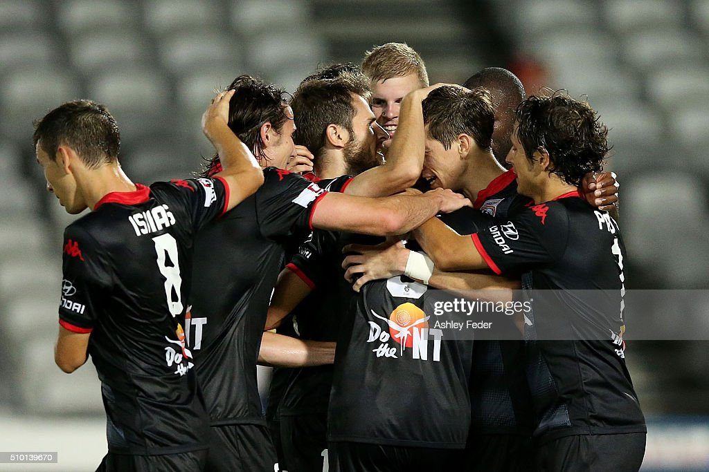 Adelaide United team mates celebrate a goal during the round 19 A-League match between the Central Coast Mariners and Adelaide United at Central Coast Stadium on February 14, 2016 in Gosford, Australia.