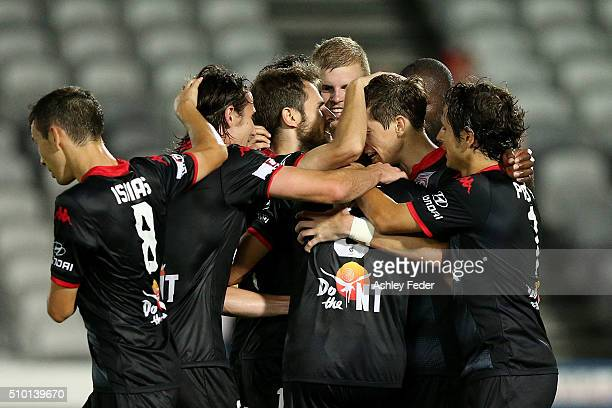 Adelaide United team mates celebrate a goal during the round 19 ALeague match between the Central Coast Mariners and Adelaide United at Central Coast...