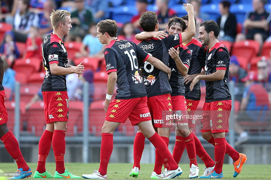Adelaide United team mates celebrate a goal during the round 23 ALeague match between the Newcastle Jets and Adelaide United at Hunter Stadium on...