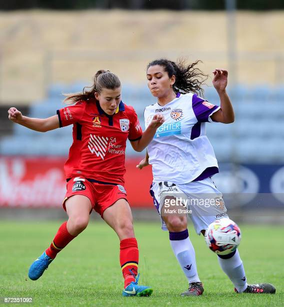 Adelaide United's Emily Hodgson competes with Perth's Raquel Rodriguez during the round three WLeague match between Adelaide United and the Perth...