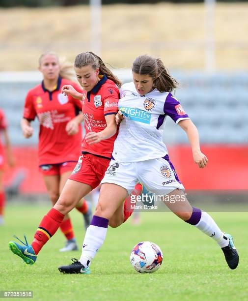 Adelaide United's Emily Hodgson competes with Perth's Shawn Billam during the round three WLeague match between Adelaide United and the Perth Glory...