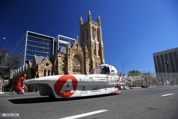 Adelaide University Solar Racing Team vehicle 'Lumen II' from Australia competes during a street parade for the 2017 Bridgestone World Solar...