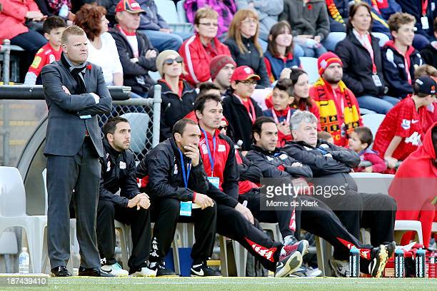 Adelaide's coaching bench looks on during the round five ALeague match between Adelaide United and the Newcastle Jets at Coopers Stadium on November...