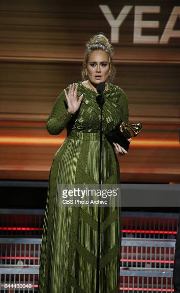 Adele accepts the Grammy Award for Song of the Year during THE 59TH ANNUAL GRAMMY AWARDS broadcast live from the STAPLES Center in Los Angeles Sunday...