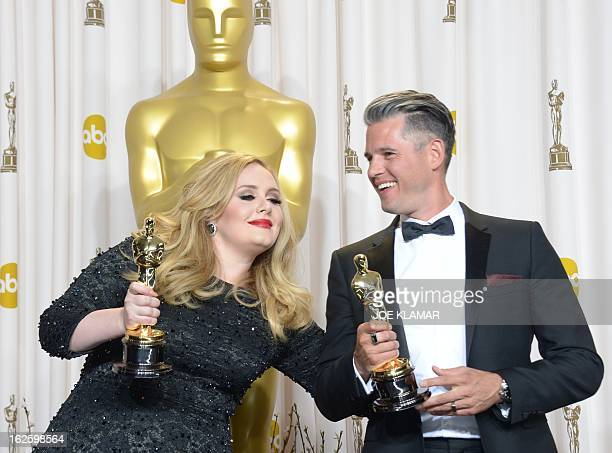 Adele Adkins and and Paul Epworth hold the Best Original Song Award for Skyfall from the movie 'Skyfall' in the press room during the 85 Academy...