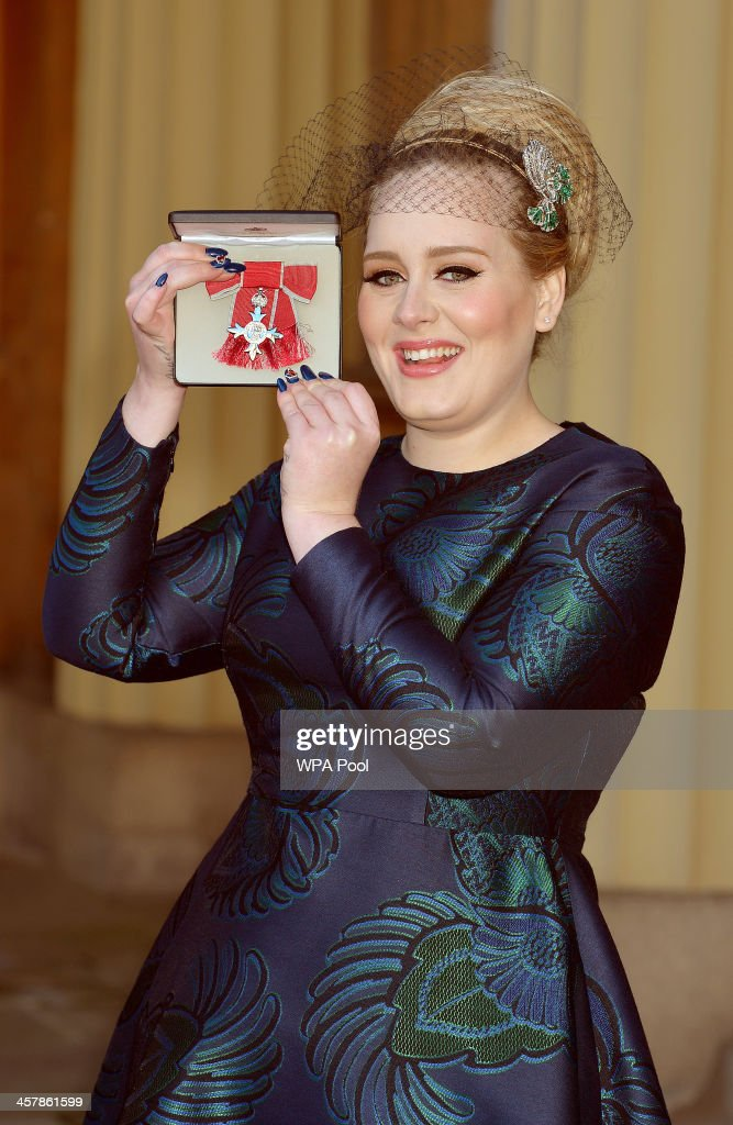 <a gi-track='captionPersonalityLinkClicked' href=/galleries/search?phrase=Adele+-+Singer&family=editorial&specificpeople=4898935 ng-click='$event.stopPropagation()'>Adele</a> Adkins MBE holds her MBE award for services to music after it was presented to her by the Prince of Wales at an Investiture ceremony at Buckingham Palace on December 19, 2013 in London, England.