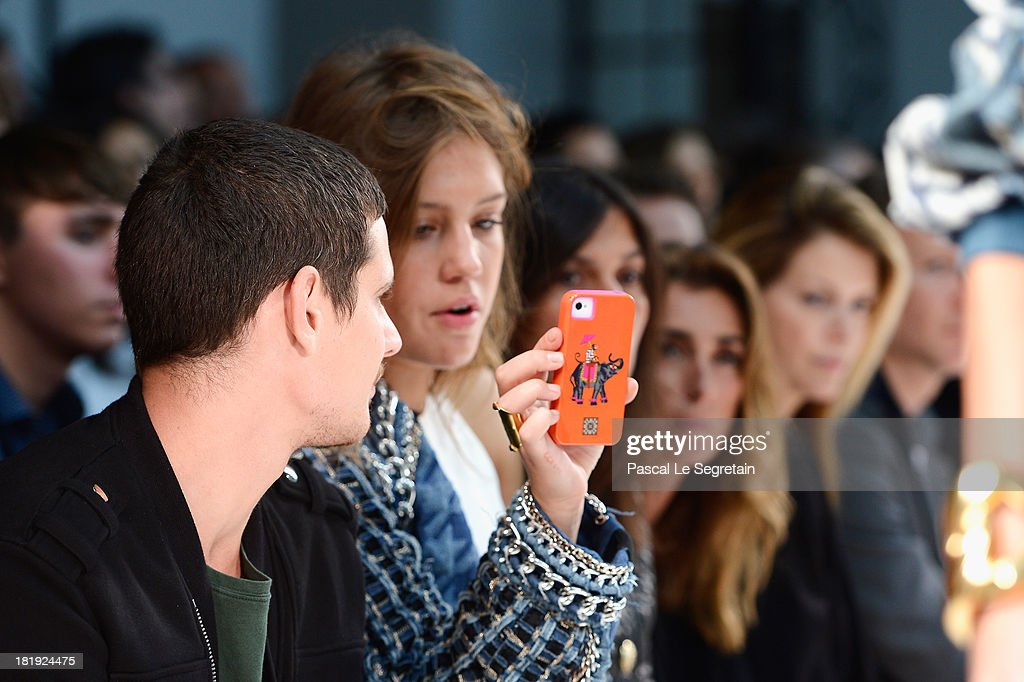 Adele Exarchopoulos (R) and her boyfriend Jeremie Laheurte attend the Balmain show as part of the Paris Fashion Week Womenswear Spring/Summer 2014 at Grand Hotel Intercontinental on September 26, 2013 in Paris, France.