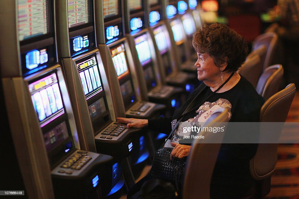 Adele Jalens plays a slot machine during the grand opening of the newest building at the Seminole Casino Coconut Creek on December 17, 2010 in Coconut Creek, Florida. The site offers up an additional 400-plus gaming positions, a new restaurant and a new venue with more space to gamble, dine and party.