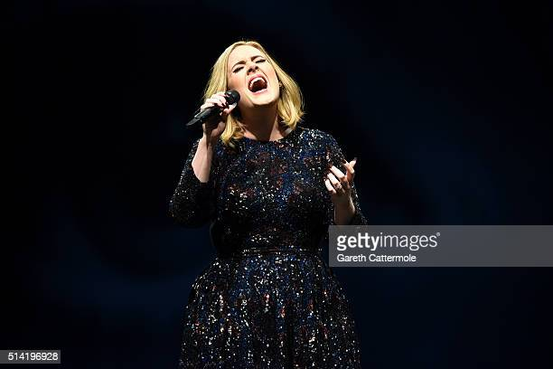 Adele performs on stage at Manchester Arena on March 7 2016 in Manchester England