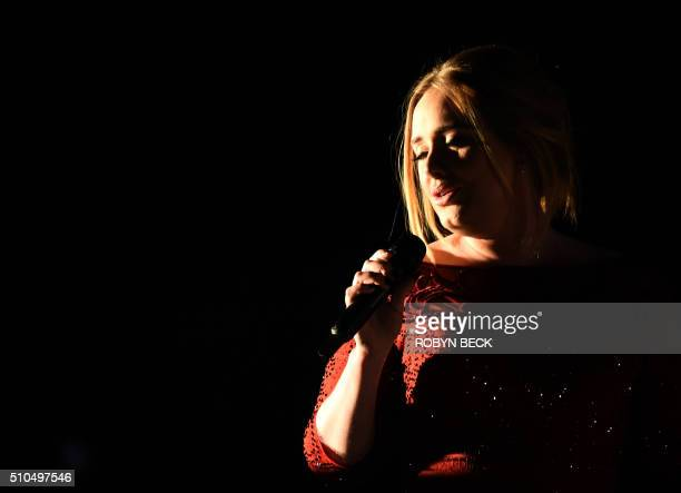 TOPSHOT Adele performs onstage during the 58th Annual Grammy music Awards in Los Angeles February 15 2016 AFP PHOTO/ ROBYN BECK / AFP / ROBYN BECK
