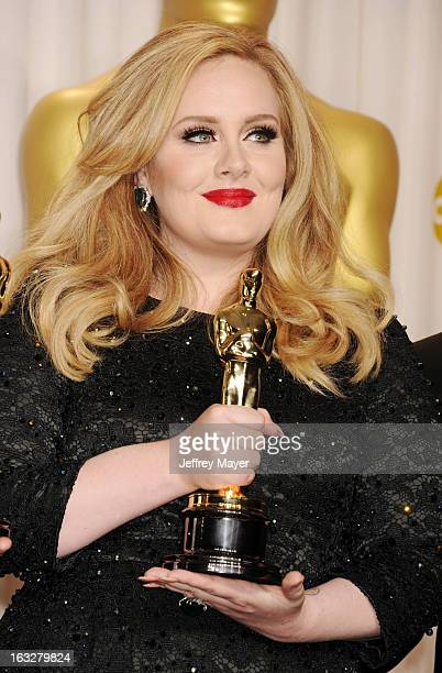 Adele poses in the press room the 85th Annual Academy Awards at Dolby Theatre on February 24 2013 in Hollywood California