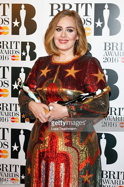 Adele poses in the winners room at the BRIT Awards 2016 at The O2 Arena on February 24 2016 in London England