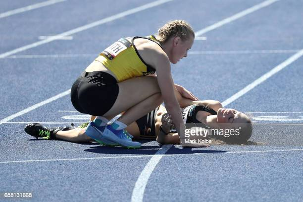 Adele Smith of Western Australia checks on Kaitlyn Wilson of Western Australia after the women under 17s 400m final on day two of the 2017 Australian...