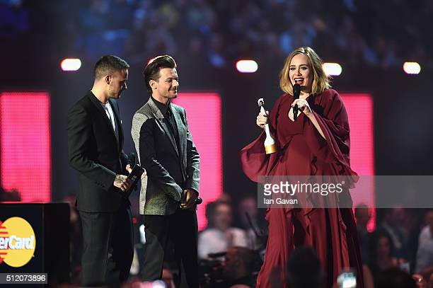 Adele with her Best British Female Solo Artist award on stage with award presenters Liam Payne and Louis Tomlinson at the BRIT Awards 2016 at The O2...