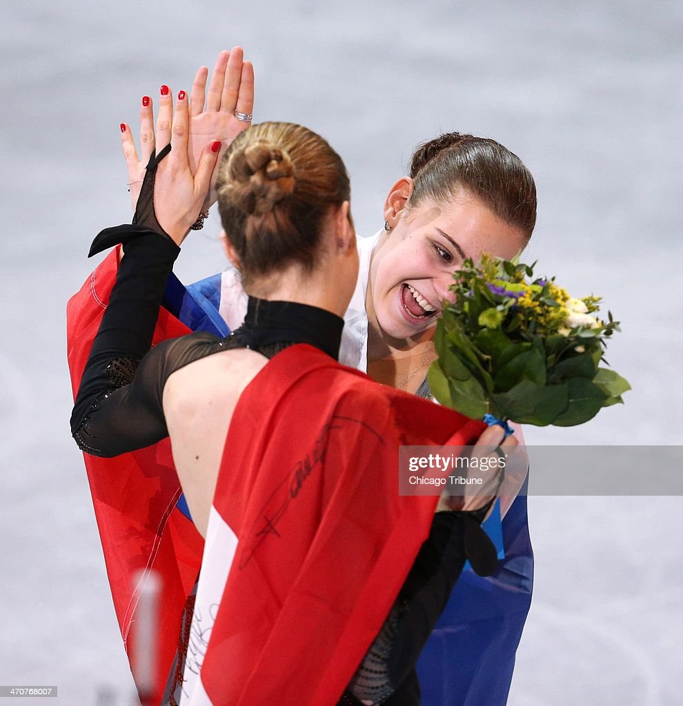 Adelina Sotnikova (right) celebrates her gold medal performance with bronze medalist Carolina Kostner of Italy after the ladies' figure skating free skate at the Iceberg Skating Palace during the Winter Olympics in Sochi, Russia, Thursday, Feb. 20, 2014.