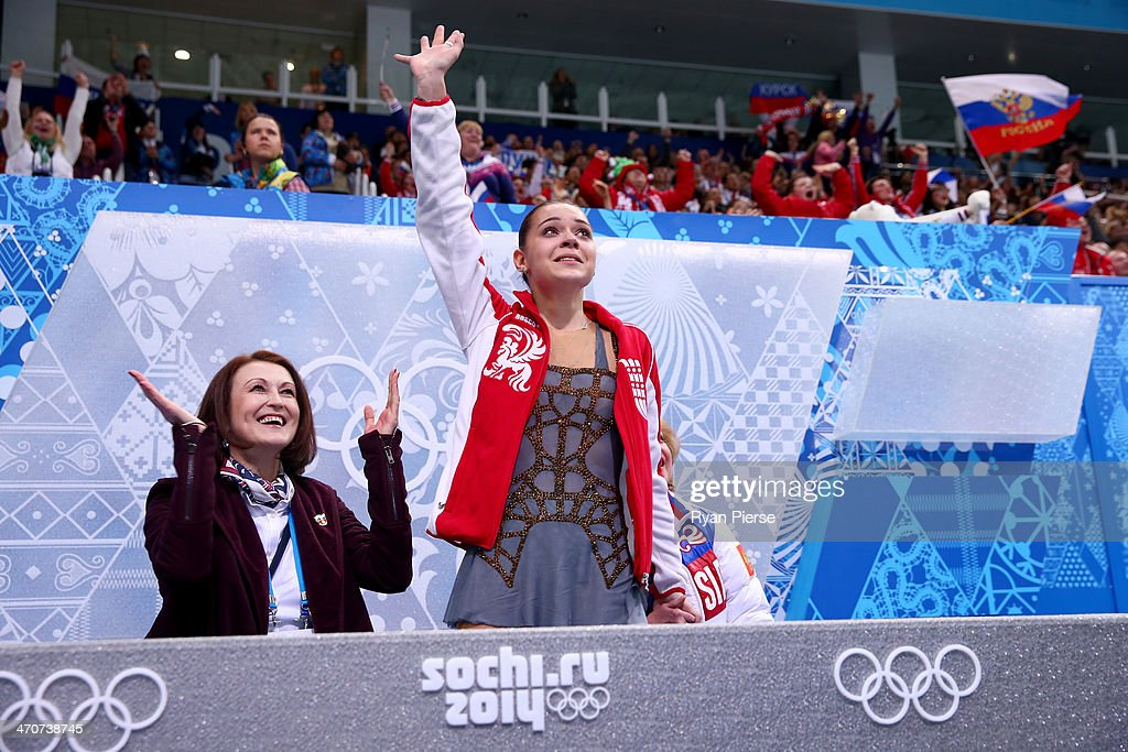 <a gi-track='captionPersonalityLinkClicked' href=/galleries/search?phrase=Adelina+Sotnikova&family=editorial&specificpeople=7380612 ng-click='$event.stopPropagation()'>Adelina Sotnikova</a> of Russia waves to fans after her socre announced in the Figure Skating Ladies' Free Skating on day 13 of the Sochi 2014 Winter Olympics at Iceberg Skating Palace on February 20, 2014 in Sochi, Russia.