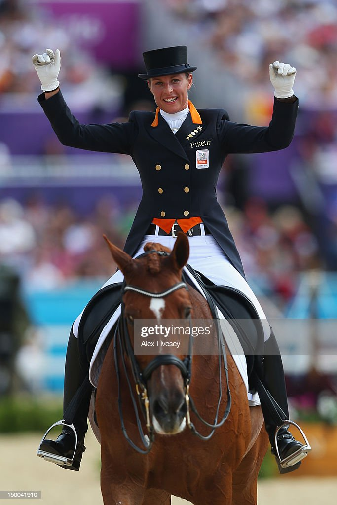 <a gi-track='captionPersonalityLinkClicked' href=/galleries/search?phrase=Adelinde+Cornelissen&family=editorial&specificpeople=5427385 ng-click='$event.stopPropagation()'>Adelinde Cornelissen</a> of Netherlands riding Parzival celebrates during the Individual Dressage on Day 13 of the London 2012 Olympic Games at Greenwich Park on August 9, 2012 in London, England.