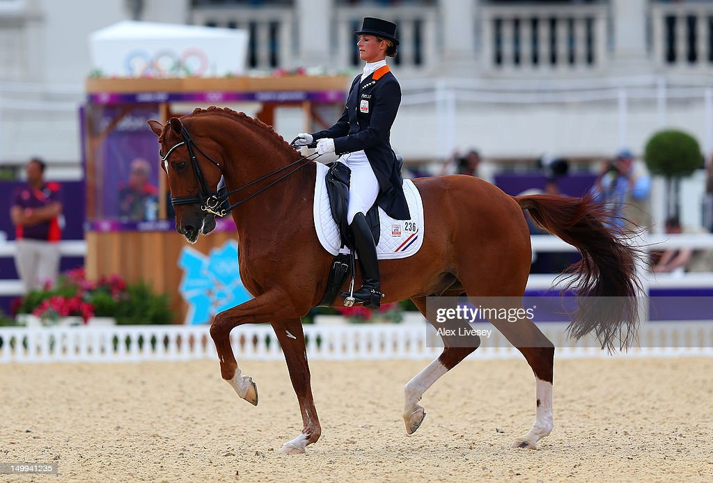 <a gi-track='captionPersonalityLinkClicked' href=/galleries/search?phrase=Adelinde+Cornelissen&family=editorial&specificpeople=5427385 ng-click='$event.stopPropagation()'>Adelinde Cornelissen</a> of Netherlands riding Parzival competes in the Team Dressage Grand Prix Special on Day 11 of the London 2012 Olympic Games at Greenwich Park on August 7, 2012 in London, England.