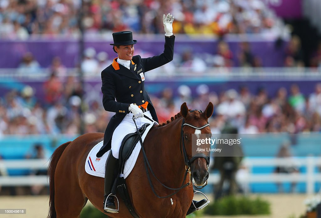 <a gi-track='captionPersonalityLinkClicked' href=/galleries/search?phrase=Adelinde+Cornelissen&family=editorial&specificpeople=5427385 ng-click='$event.stopPropagation()'>Adelinde Cornelissen</a> of Netherlands riding Parzival competes in the Individual Dressage on Day 13 of the London 2012 Olympic Games at Greenwich Park on August 9, 2012 in London, England.