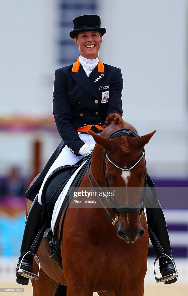 <a gi-track='captionPersonalityLinkClicked' href=/galleries/search?phrase=Adelinde+Cornelissen&family=editorial&specificpeople=5427385 ng-click='$event.stopPropagation()'>Adelinde Cornelissen</a> of Netherlands riding Parzival smiles as she competes in the Team Dressage Grand Prix Special on Day 11 of the London 2012 Olympic Games at Greenwich Park on August 7, 2012 in London, England.