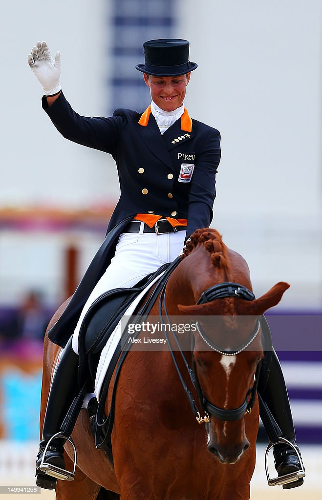 <a gi-track='captionPersonalityLinkClicked' href=/galleries/search?phrase=Adelinde+Cornelissen&family=editorial&specificpeople=5427385 ng-click='$event.stopPropagation()'>Adelinde Cornelissen</a> of Netherlands riding Parzival waves as after competing in the Team Dressage Grand Prix Special on Day 11 of the London 2012 Olympic Games at Greenwich Park on August 7, 2012 in London, England.