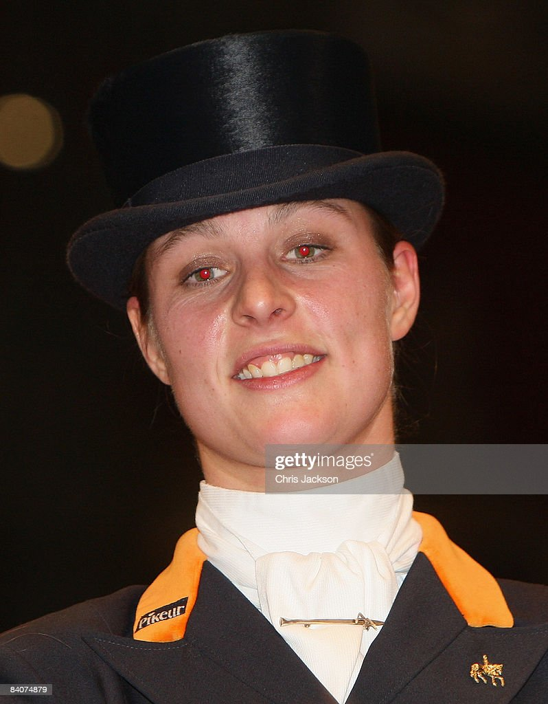 <a gi-track='captionPersonalityLinkClicked' href=/galleries/search?phrase=Adelinde+Cornelissen&family=editorial&specificpeople=5427385 ng-click='$event.stopPropagation()'>Adelinde Cornelissen</a> of the Netherlands is seen on Parzival after winning the FEI World Cup Dressage first place award at the Olympia Horse Show on December 17, 2008 in London, England. Camilla, Duchess of Cornwall presented awards at the event in addition to meeting with competitors backstage.