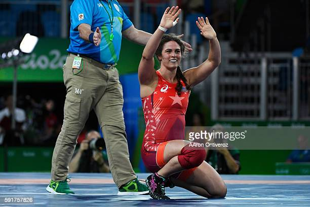 Adeline Gray of the United States celebrates her win by way of a fall over Andrea Olaya of Columbia during women's freestyle wrestling round of 16 on...